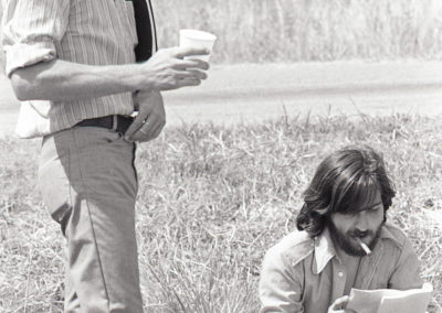 Writer Kim Henkel and Director Tobe Hooper sitting outside the Chainsaw House