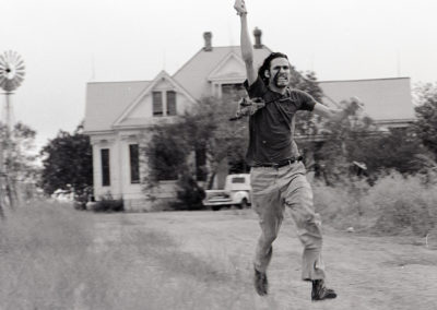 Ed Neal as The Hitchhiker